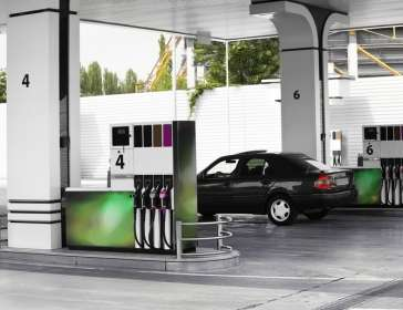 a car filling up at a petrol station