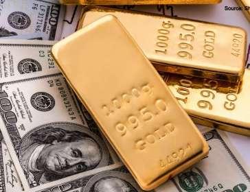 Gold bars and dollar bills