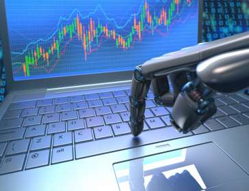 robotic hand executing a stock trade on a computer