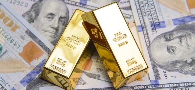 gold bars on US dollars